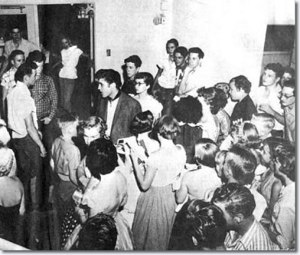 Elvis at the coliseum with Buddy Holley and Bob Montgomery looking on - June 3, 1955