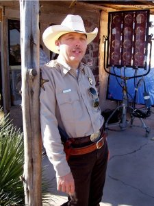 As the Sheriff on set