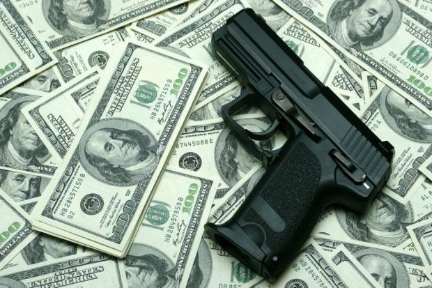 140417-poulos-guns-money-tease_odrvof-905x603